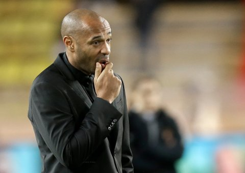 Monaco coach Thierry Henry watches the players as they train before the Champions League Group A soccer match between Monaco and Club Brugge at the Louis II stadium in Monaco, Tuesday, Nov. 6, 2018. (AP Photo/Claude Paris)