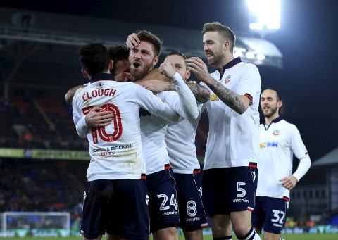 Bolton Wanderers' James Henry (no.24) celebrates scoring his side's first goal of the game with team-mates during the English FA Cup third round replay soccer match at Selhurst Park, London, Tuesday Jan. 17, 2017.  (Tim Goode / PA via AP)