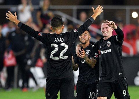 Wayne Rooney (midten) er spilleren DC United må stole på i natt.  (AP Photo/Nick Wass)