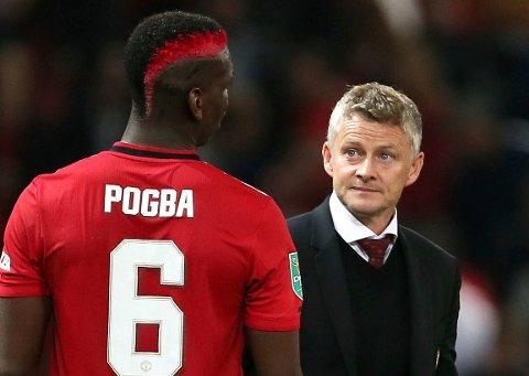 Paul Pogba tjente 316 millioner kroner sist sesong. Her sammen med manager Ole Gunnar Solskjær.