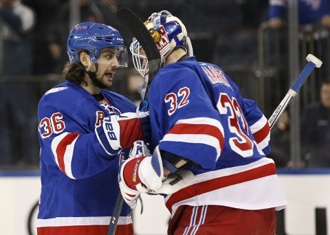 New York Rangers' right wing Mats Zuccarello (36), of Norway, congratulates Rangers' goalie Antti Raanta (32), of Finland, after the Raanta earned his second shutout in as many games in an NHL hockey game against the New Jersey Devils at Madison Square Garden in New York, Sunday, Dec. 11, 2016. Rant had 19 saves as the Rangers shut out the Devils 5-0. (AP Photo/Kathy Willens)