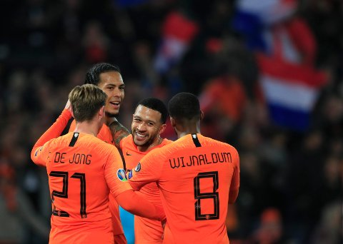 Netherlands' Virgil Van Dijk celebrates with teammates after scoring his side's fourth goal during their Euro 2020 group C qualifying soccer match between Netherlands and Belarus at the Feyenoord stadium in Rotterdam, Netherlands, Thursday, March 21, 2019. (AP Photo/Peter Dejong)
