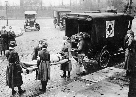 Influenza epidemic in United States. St. Louis, Missouri, Red Cross Motor Corps on duty, October 1918. (National Archives)