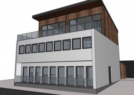 FÅR TROLIG NEI: Slik ser Bolighuset AS for seg at Strandgata 5B skal bli etter en ombygging, men kommunen vil trolig ikke godkjenne den omsøkte loftsetasjen.