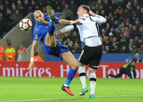 Leicester's Yohan Benalouane, left, competes for the ball with Derby's Richard Keogh during the English FA Cup Fourth Round replay soccer match between Leicester City and Derby County at the King Power Stadium in Leicester, England, Wednesday, Feb. 8, 2017. (AP Photo/Rui Vieira)