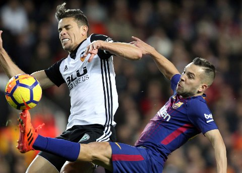 Barcelona's Jordi Alba, right, vies for the ball withl Valencia's Grabiel Paulista during the Spanish La Liga soccer match between Valencia and FC Barcelona at the Mestalla stadium in Valencia, Spain, Sunday, Nov. 26, 2017. (AP Photo/Alberto Saiz)