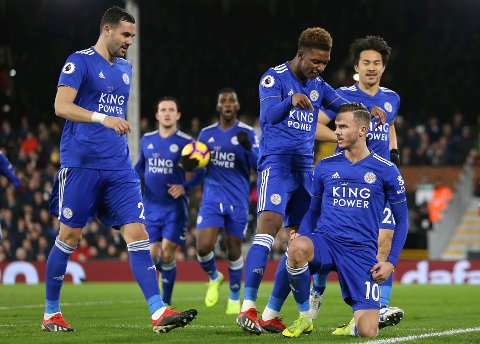 Leicester City's James Maddison, right, celebrates scoring his side's first goal of the game against Fulham during their English Premier League soccer match at Craven Cottage in London, Wednesday Dec. 5, 2018. (Steven Paston/PA via AP)