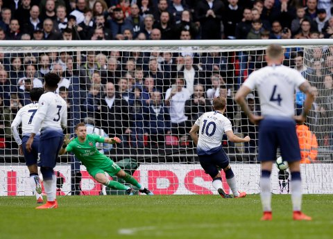 Tottenham's Harry Kane, second right, scores his side's opening goal from penalty during the English Premier League soccer match between Tottenham Hotspur and Arsenal at Wembley stadium in London, Saturday, March 2, 2019. (AP Photo/Tim Ireland)