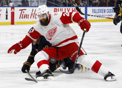 Detroit Red Wings forward Luke Witkowski (28) goes after the puck during the second period of an NHL hockey game against the Buffalo Sabres, Tuesday Oct. 24, 2017, in Buffalo, N.Y. (AP Photo/Jeffrey T. Barnes)
