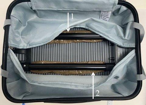 BESLAG: Deler av beslaget som er gjort i saken, ble funnet gjemt i denne kofferten.