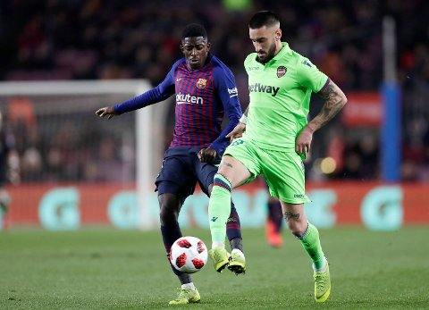 FC Barcelona's Dembele, left, duels for the ball with Levante's Erick Cabaco during a Spanish Copa del Rey soccer match between FC Barcelona and Levante at the Camp Nou stadium in Barcelona, Spain, Thursday, Jan. 17, 2019. (AP Photo/Manu Fernandez)