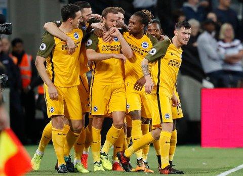 Brighton og Glenn Murray har vist fine takter i oktober. Spillsenteret tror de kan vinne på bortebane mot et Swansea-lag som sliter.