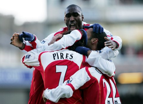 Arsenal's Robert Pires celebrates with Sol Campbell (top) after scoring against Fulham during their English Premiership soccer match played at HIghbury, London, England. Sunday Dec. 26 2004. (AP Photo/Paul Ellis) **NO INTERNET/MOBILE USEAGE WITHOUT FAPL LICENCE - SEE IPTC SPECIAL INSTRUCTIONS FIELD FOR DETAILS**