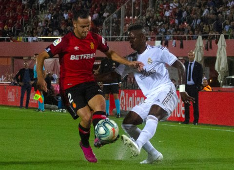 Mallorca's Joan Sastre, left, fights for the ball with Real Madrid's Vinicius Junior during the Spanish La Liga soccer match between Mallorca and Real Madrid at the Iberostar Estadi in Palma de Mallorca, Spain, Saturday, Oct. 19, 2019. (AP Photo/Francisco Ubilla)