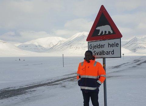 Da Adam flyktet fra Sudan etter at faren hans ble drept i krig og moren og resten av familien var på rømmen, kunne han ikke se for seg at han skulle jobbe på Svalbard bare få år senere.