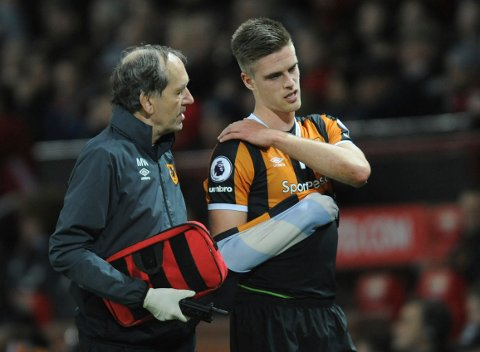 Hull City's Markus Henriksen, his arm in a makeshift sling is escorted off the pitch after being injured during the English League Cup semifinal, 1st leg, soccer match between Manchester United and Hull at Old Trafford stadium in Manchester, England, Tuesday, Jan. 10, 2017. (AP Photo/Rui Vieira)