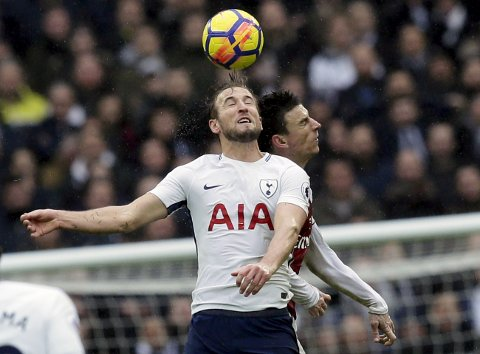 Tottenham's Harry Kane, front, and Arsenal's Laurent Koscielny battle for the ball during the English Premier League soccer match between Tottenham Hotspur and Arsenal at Wembley Stadium, London, Saturday, Feb. 10, 2018. (AP Photo/Tim Ireland)