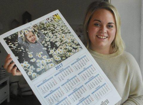 Siste vinner: I fjor ble det ikke arrangert fotokonkurranse for avisens kalenderbilde. I 2016 vant Elise Madsen Henriksen med et bilde av datteren Tuva i en herlig blomstereng.Arkivfoto