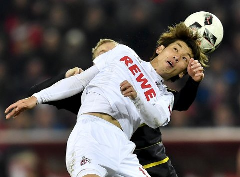 Cologne's Yuya Osako jumps for the ball during the German Bundesliga soccer match between 1. FC Cologne and Borussia Dortmund in Cologne, Germany, Saturday, Dec. 10, 2016. The match ended 1-1. (AP Photo/Martin Meissner)