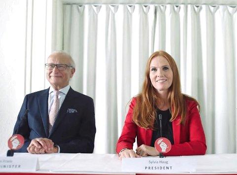 Herman Friele spiller finansminister under sitt eget navn og Sølvi Rolland spiller president Sylvia Haug i nasjonen Bergen i en nylansert VG-reklame.