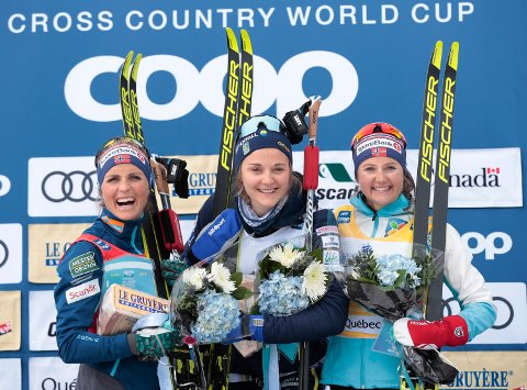 Sweden's Stina Nilsson, center, celebrates her victory with second-place finisher Therese Johaug, left, of Norway, and third-place finisher Ingvild Flugtad Oestberg, right, of Norway, after the women's 10-km mass start classic, Saturday, March 23, 2019, at the cross country skiing World Cup in Quebec City. (Jacques Boissinot/The Canadian Press via AP)
