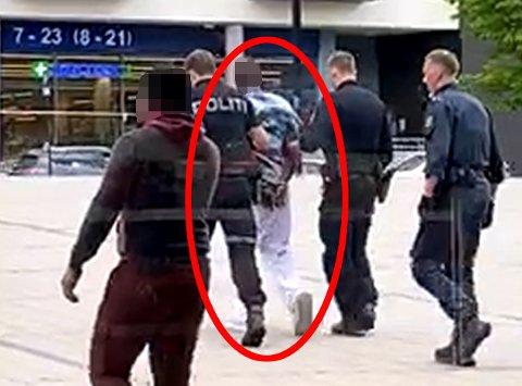 GELEIDET UT: Her blir mannen, som for tiden sitter varetektsfengslet, pågrepet på Lillestrøm stasjon. Se video litt lenger ned i artikkelen. Foto: RB-TIPSER