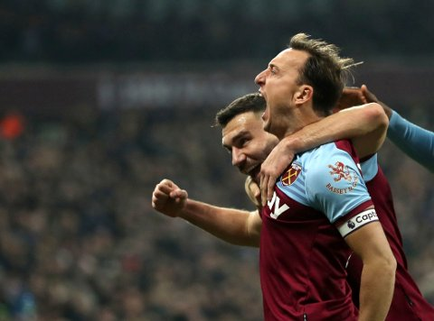 West Ham United's Mark Noble, celebrates scoring his side's first goal of the game against Bournemouth, during their English Premier League soccer match at the London Stadium, in London, Wednesday Jan. 1, 2020. (Bradley Collyer/PA via AP)