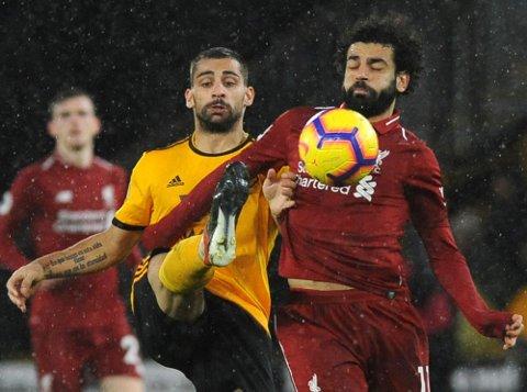 Liverpool og Mohamed Salah (t.h.)  er toppscorer hos Liverpool denne sesongen. (AP Photo/Rui Vieira)