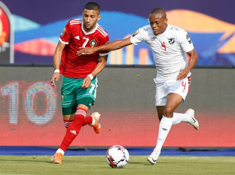 Morocco's Hakim Ziyach, left, and Namibia's Riaan Hanamub fight for the ball during the African Cup of Nations group D soccer match between Morocco and Namibia in Al Salam Stadium in Cairo, Egypt, Sunday, June 23, 2019. (AP Photo/Ariel Schalit)