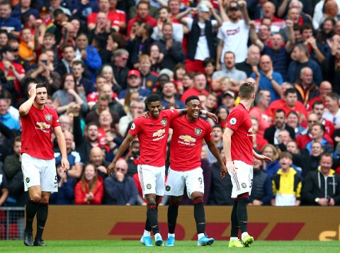 Manchester United's Anthony Martial, 2nd right, celebrates with teammates after scoring his sides second goal during the English Premier League soccer match between Manchester United and Chelsea at Old Trafford in Manchester, England, Sunday, Aug. 11, 2019. (AP Photo/Dave Thompson)