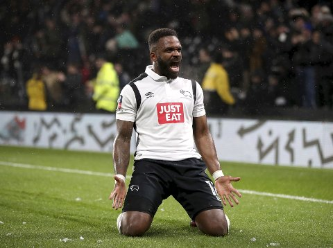 Derby County's Darren Bent celebrates scoring his side's first goal during the English FA Cup fourth round soccer match between Leicester City and Derby County at Pride Park, Derby, England, Friday, Jan. 27, 2017. (Nick Potts/PA via AP)