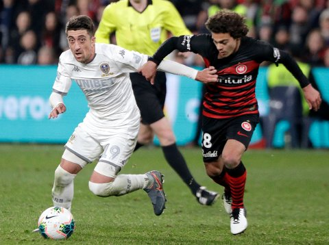 Leeds United's Pablo Hernandez, left, gets past Western Sydney Wanderers' Fabian Monge during their friendly soccer match in Sydney, Australia, Saturday, July 20, 2019. (AP Photo/Rick Rycroft)