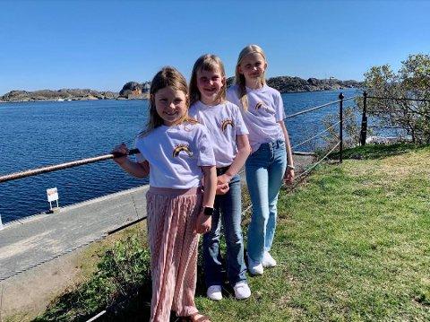 HJELPERE: Augusta Louise Geirsdatter Titlestad (6), Hedvig Carlsten Hill-Jensen (7) og Emma Andersen (10) vil hjelpe barna i Moria og selger t-skjorter som kan gi penger til de som trenger det mer enn de selv.