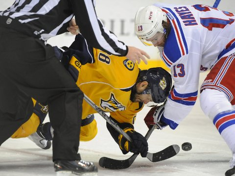 Feb 7, 2015; Nashville, TN, USA; Nashville Predators center Paul Gaustad (28) battles with New York Rangers right winger Kevin Hayes (13) for a face off during the second period at Bridgestone Arena. Mandatory Credit: Christopher Hanewinckel-USA TODAY Sports