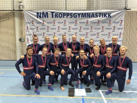 MEDALJEDRYSS: Troppsturnere fra Drammens Turnforening forsynte seg bra av medaljefatet under NM i troppsgymnastikk i Bergen sist helg.
