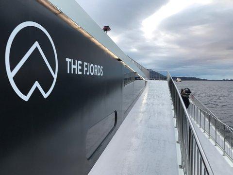 Visningstur med Vision of the fjords i Florø . Fjord1 og Flåm AS sitt turistfartøy.