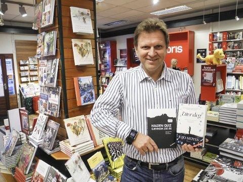 HARDE PAKKER: – Her er toppselgerne av lokale og ikke lokale bøker, sier bokhandler Jo Køhn.