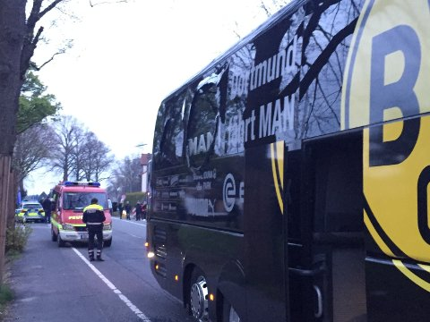 A window of the bus of Borussia Dortmund is damaged after an explosion before the Champions League quarterfinal soccer match against AS Monaco in Dortmund, western Germany, Tuesday, April 11, 2017. (Carsten Linhoff/dpa via AP)