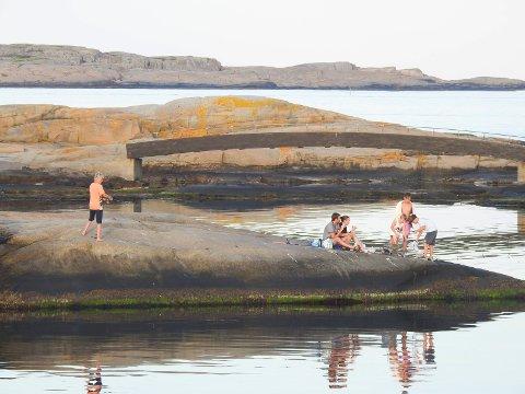 Fisker i solnedgang på Verdens Ende.