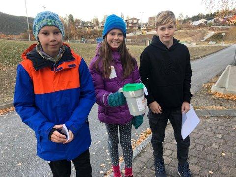 Tobias Berg, Gia Drageset Tråslett og Heine Jonassen går med bøsse for TV-aksjonen på Gruben i dag.