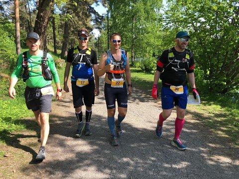 Fra venstre: Lars Erik Gylland (Hell), Jørgen Strand (Tofte), Norvald Andreassen (Fevik) og Jørgen Tellefsen (Stjørdal) er ved godt mot til tross for at de har seks timer igjen til fots før de er fremme ved Verdens Ende.