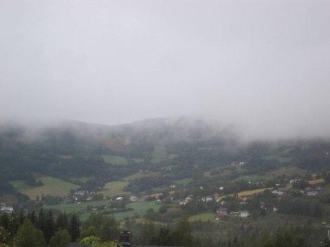 Haustleg: Grått og tungt augustvêr over Volbu i Øystre Slidre.