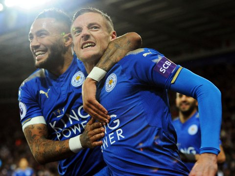 Leicester's Jamie Vardy, right, celebrates with Leicester's Danny Simpson after scoring during the English Premier League soccer match between Leicester City and Tottenham Hotspur at the King Power Stadium in Leicester, England, Tuesday, Nov. 28, 2017. (AP Photo/Rui Vieira)