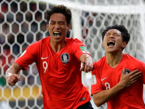South Korea's Cho Youngwook, right, celebrates with South Korea's Oh Sehun after scoring his side's second goal during the Group F U20 World Cup soccer match between Korea Republic and Argentina, in Tychy, Poland, Friday, May 31, 2019. (AP Photo/Sergei Grits)
