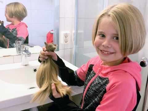 GIR VEKK HÅRET: Eira Winther Ravnaas (9) håper andre får glede av hennes lange tykke hår.