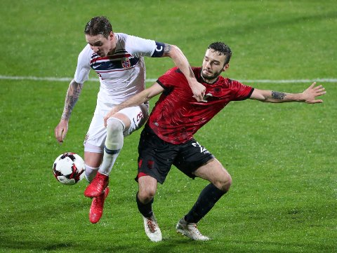 Albania's Kamer Qaka, right, and Norway's Stefan Johansen during an international friendly soccer match between Albania and Norway at Elbasan Arena in Elbasan, central Albania, Monday, March 26, 2018. (AP Photo/Hektor Pustina)