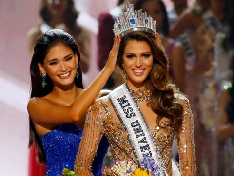Iris Mittenaere of France is crowned the new Miss Universe 2016 by 2015 Miss Universe Pia Wurtzbach in coronation Monday, Jan. 30, 2017, at the Mall of Asia in suburban Pasay city, south of Manila, Philippines. (AP Photo/Bullit Marquez)