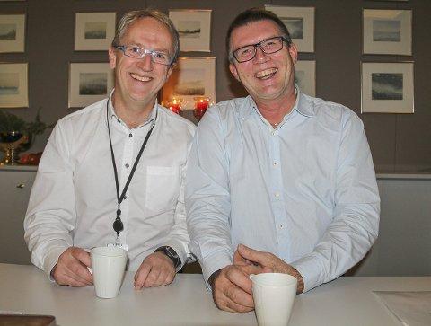 TRIVES: Ingen tvil om at disse gutta blir glade av å legge til rette for Trivselsprisen! Jan Egil Melby, DnB, og Sven O. Nylænder, KOBBL.