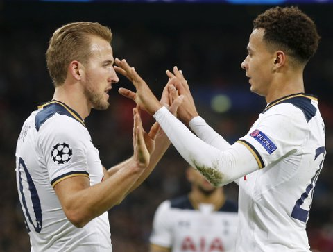 Tottenham's Dele Alli, right, is congratulated by his teammate Harry Kane after scoring his side's 3rd goal past CSKA goalkeeper Igor Akinfeev during the Champions League group E soccer match between Tottenham Hotspur and CSKA Moscow at Wembley stadium in London, Wednesday, Dec. 7, 2016. (AP Photo/Frank Augstein)