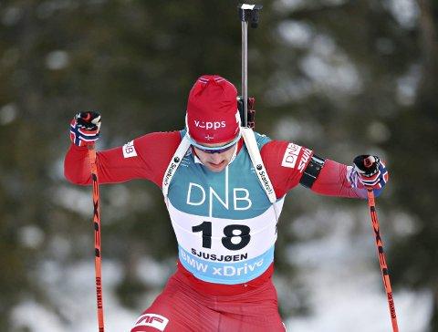 På pallen: Skiskytter Nils-Erik Ulset ble nummer tre på sprinten i verdenscupen torsdag.  Foto: Geir Olsen / NTB scanpix